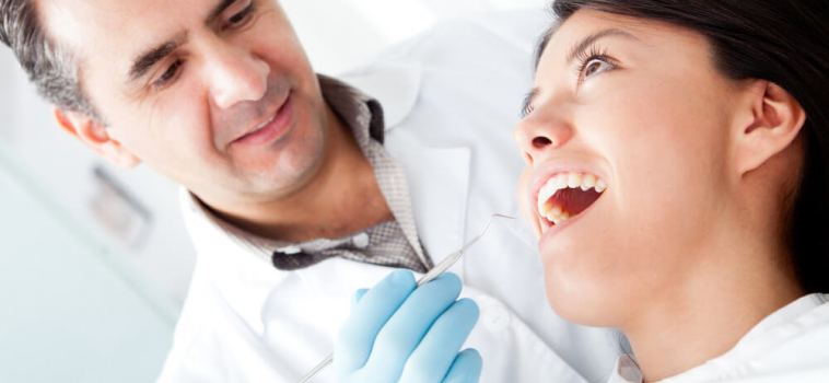 4 Signs You May Need a Root Canal, Plus: FAQ